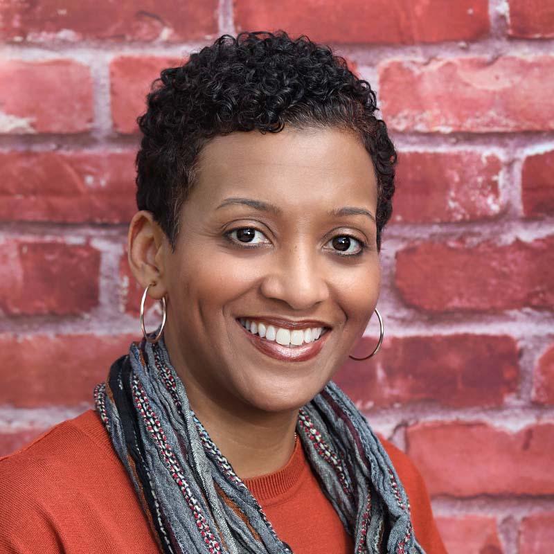 female headshot brick background