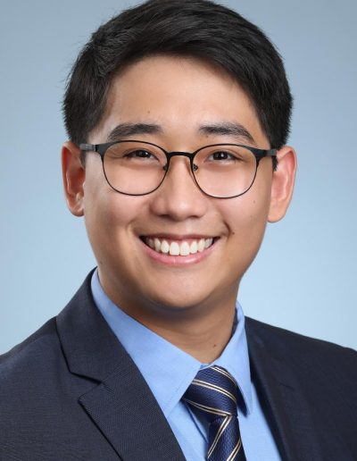 male residency headshot with suit and tie