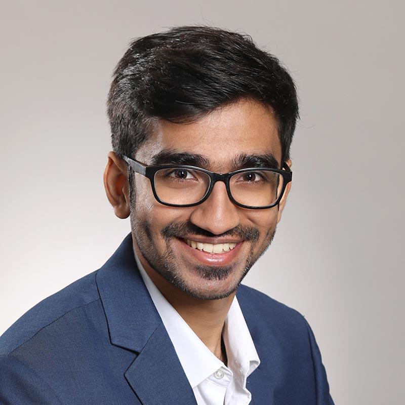 male headshot wearing eyeglasses