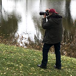 photographer by a river