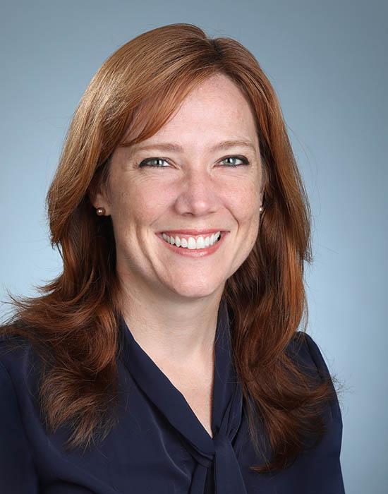 female headshot with blue background