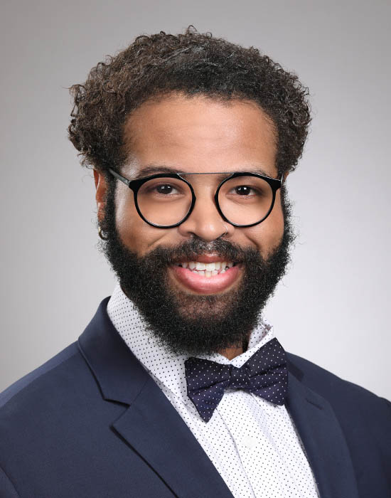 a formal male residency headshot with