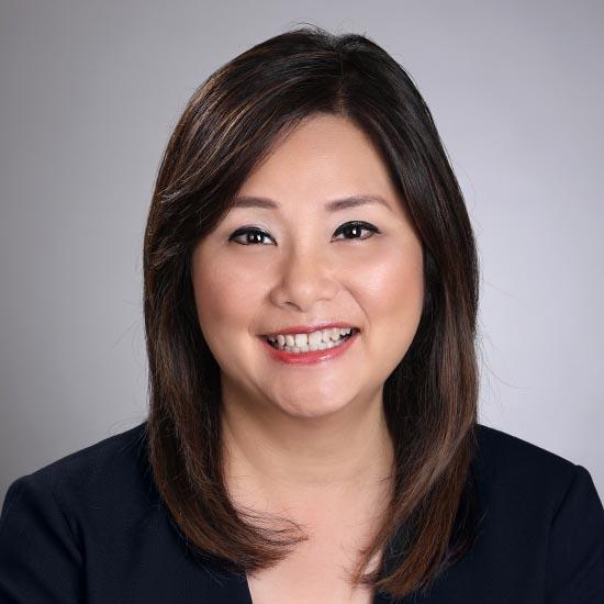 female headshot with grey background